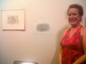 Kathleen with some of her drawings.