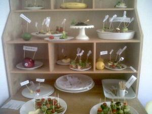 Food installation by experimental jewelry maker Radka Kovacikova, including gold toothpicks.